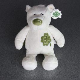 Witte ijsbeer in pluche met groene bloem